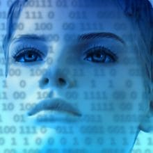 intelligent design - woman looking at binary code