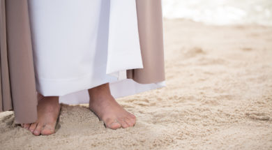 Feet of Jesus on sand