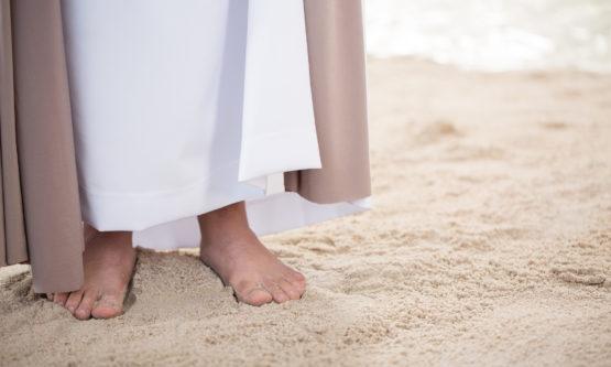 Feet of Jesus on sand